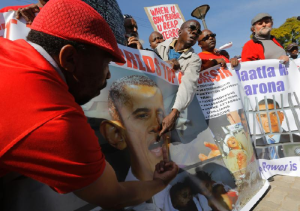 President Obama was welcomed by protestors in South Africa who clearly showed their dismay